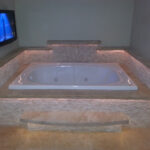 Custom stone tub surround (all travertine slabs & split face)